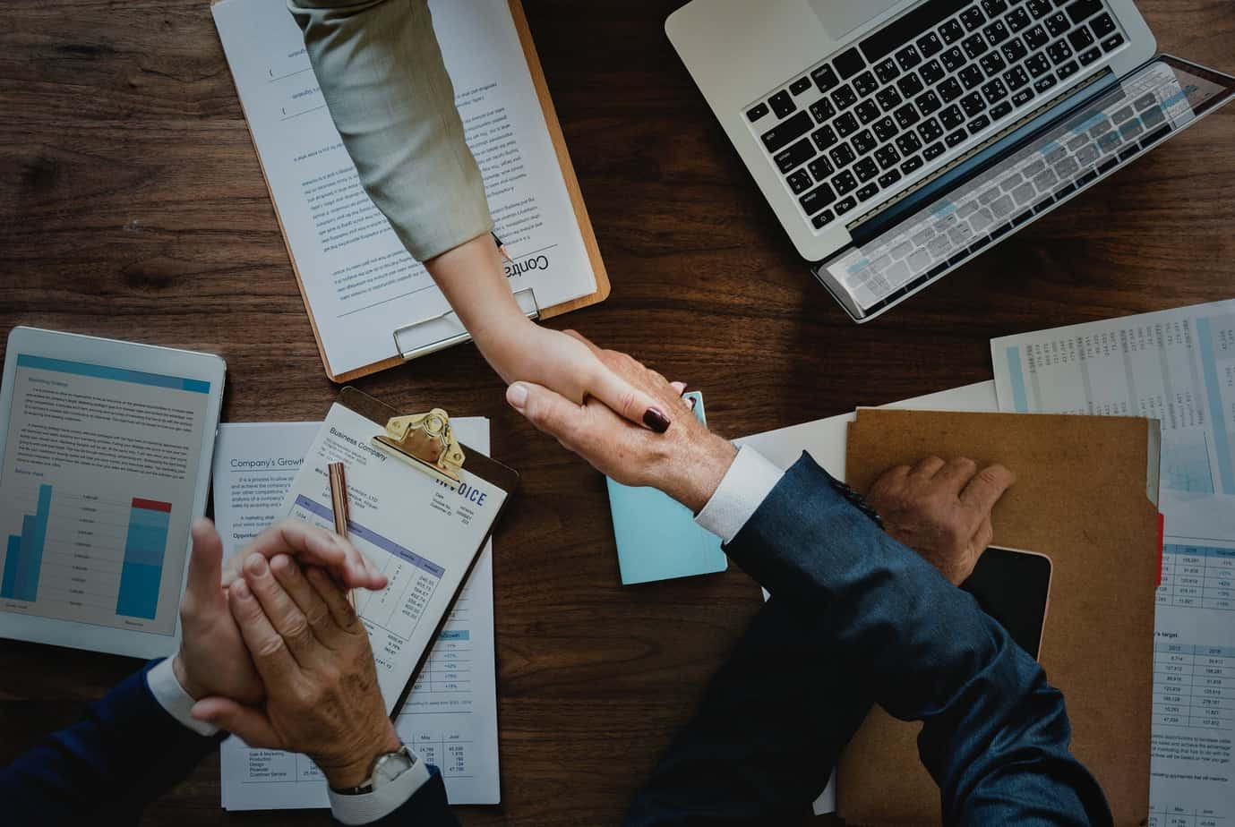 Business people shaking hands and sealing a deal