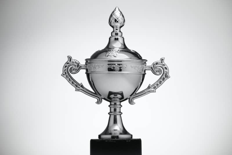 Silver trophy on a white and silver background