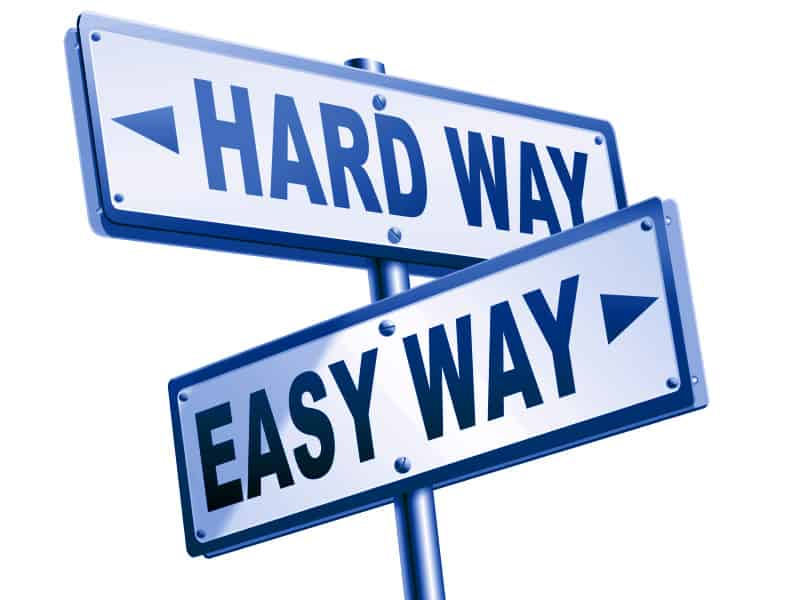 "Two road signs that read ""Hard Way"" and ""Easy Way"""