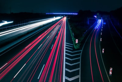 Time lapse of accelerating car lights on a highway