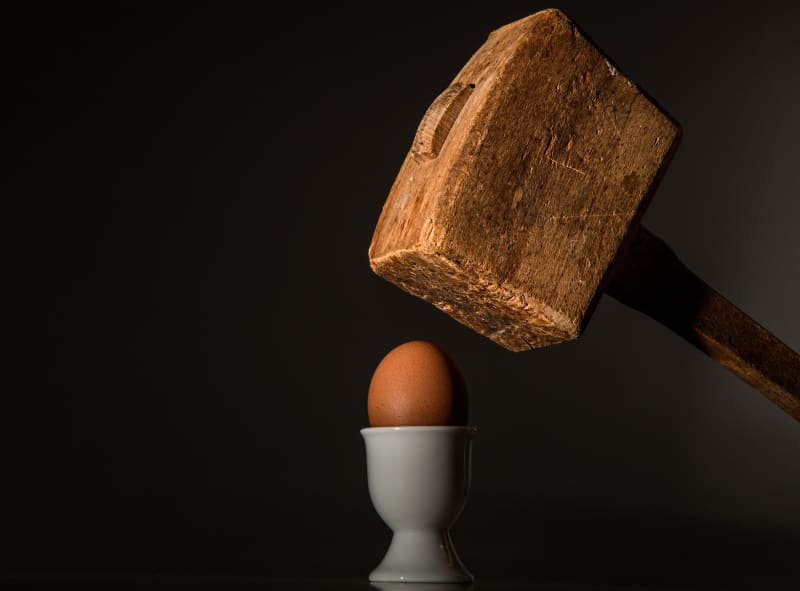 Hammer about to crack open an egg