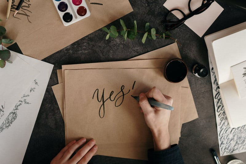 """""""Yes"""" inked onto a fancy brown envelope"""